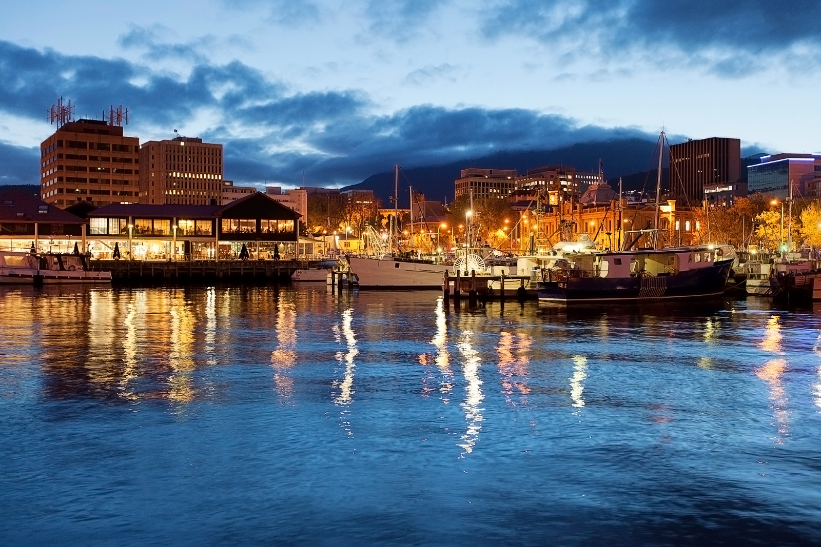 Hobart Waterfront Photographed At Night With City Skyline And Fishing Boats